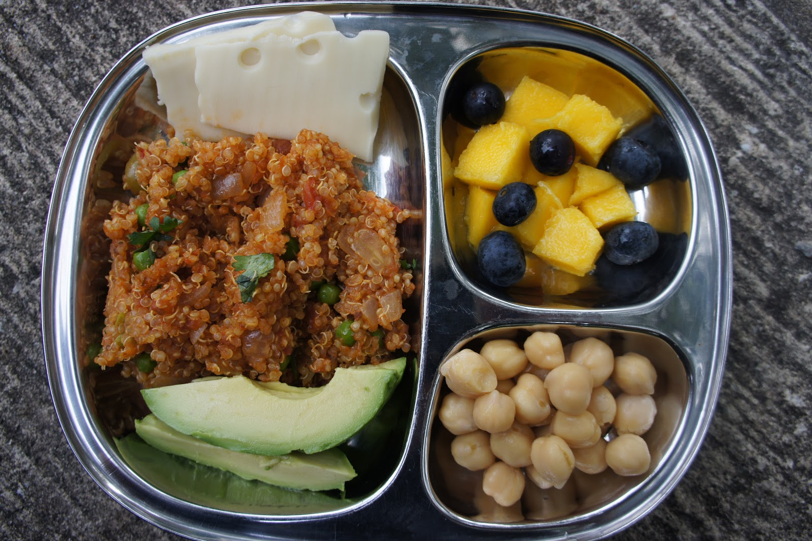 ... fresh mango and blueberries, garbanzo beans, avocado, Spanish quinoa