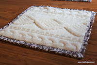http://maidenjane.blogspot.com/2013/11/upcycled-knit-sweater-hot-pad-or-trivet.html