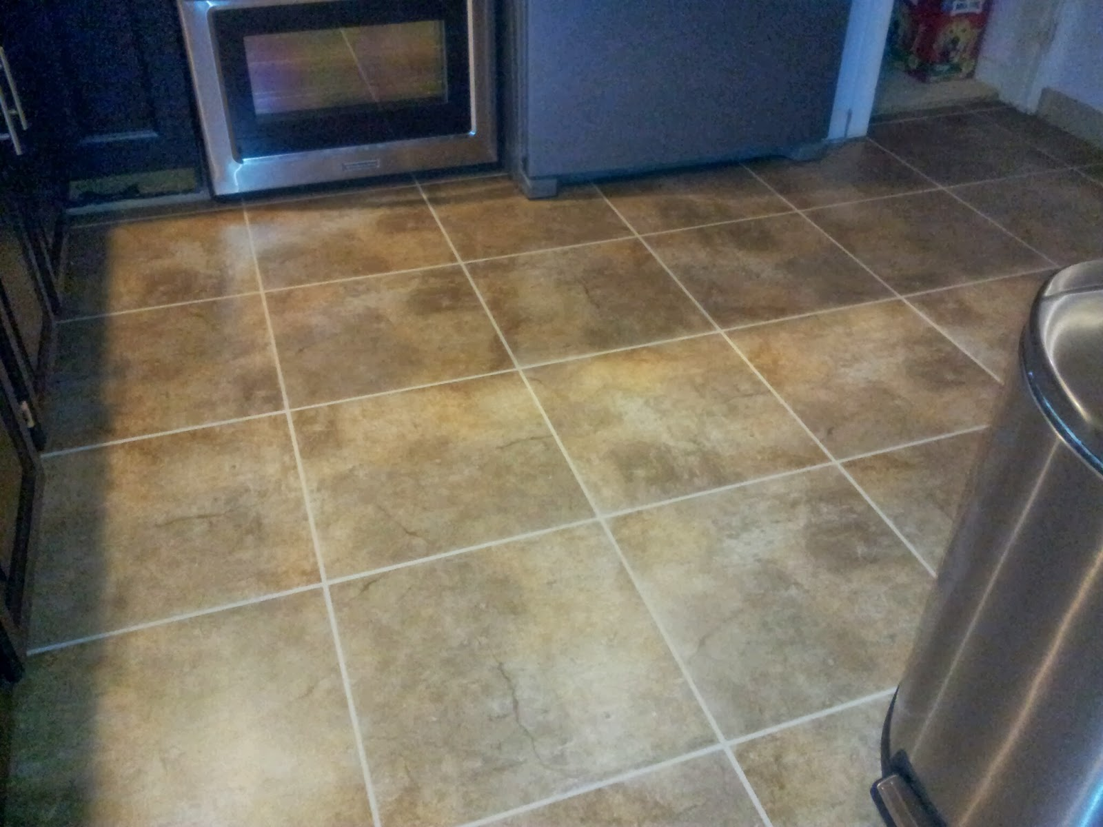 Installing snapstone kitchen floor tile for our home remodel ian kitchen tile grouting dailygadgetfo Image collections