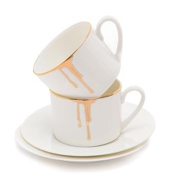 Drip gold and white coffee mugs