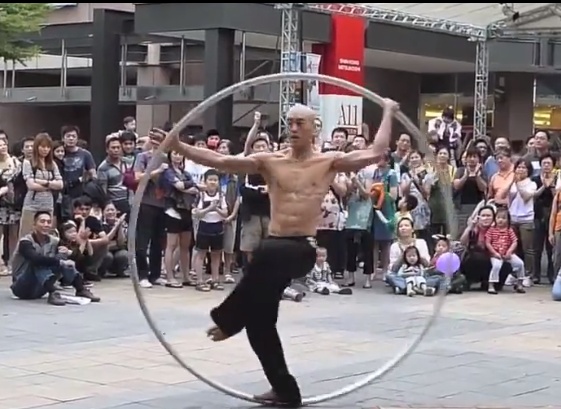 warrior monk in a giant hula hoop