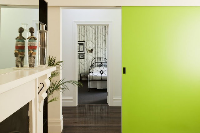Green and white walls in the hallway