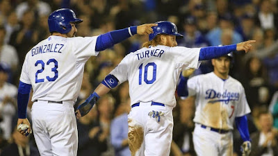 Dodgers first baseman Adrian Gonzalez and third baseman Justin Turner point at outfielder Andre Ethier after scoring on his two-run double in the fourth inning. (Allen J. Schaben / Los Angeles Times)