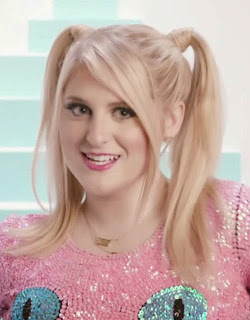 "Meghan Trainor had high pigtails with lots of loose strands in her ""Lips Are Movin"" music video"