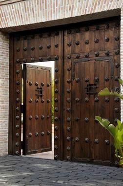 Fotos y dise os de puertas julio 2012 for Puertas metalicas para patio