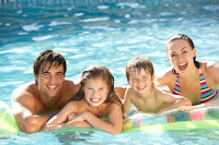 family in pool Why you should plan your big summer trip now?