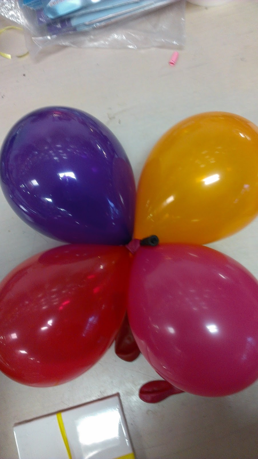 how to make balloons stick together