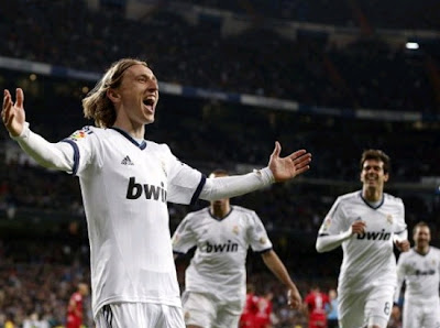 Modric celebrates a goal with Real Madrid