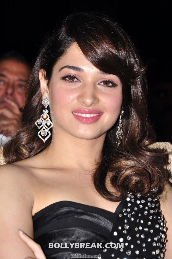 Tamanna Bhatia has donned a black off shoukder gown with some silver embellishments for this award show. In addition, we are loving that very classic hairstyle. Very Chic indeed Tamanna! - Tamanna Bhatia in black off shoulder gown