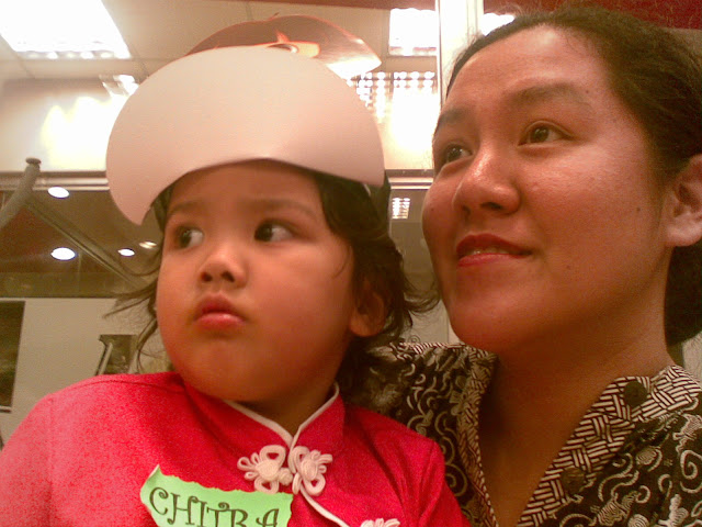 Kecil and Mama looking on