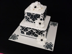 Beginners 17 Stencilled 2 tier square cake.With sugar open roses.