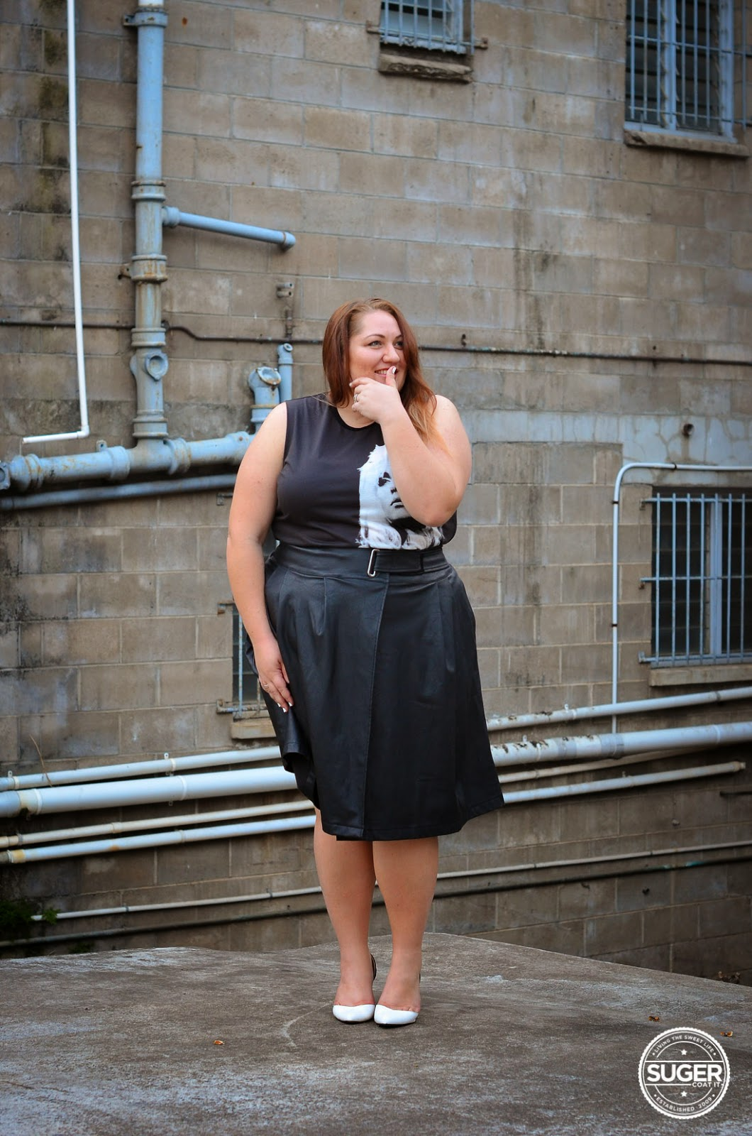 Melissa from Suger Coat It blog wearing black  sleeveless short dress, white shoes