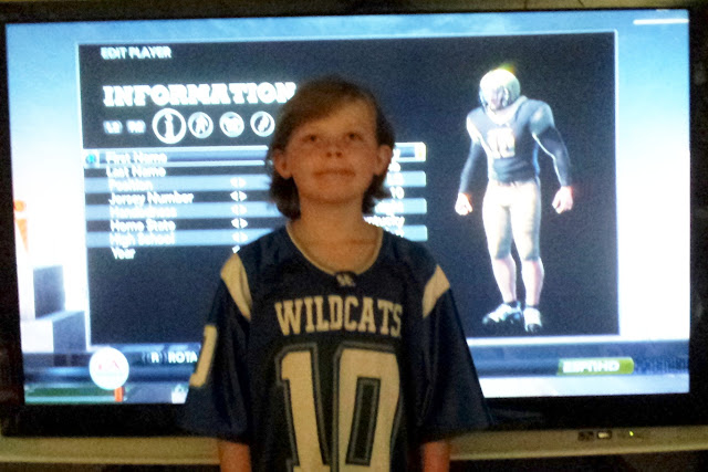 Rural Mom Youngest Son with his Custom NCAA Football 12 Player