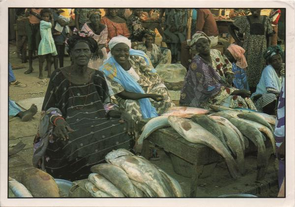 women selling fish at a market stall