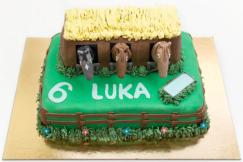 Horses in a barn fondant cake front