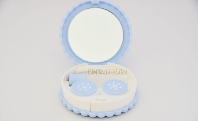 The blue Eyekan compact travel lens kit from Love Shoppingholics comes with a lens case, a bottle for multipurpose solution, tweezers, a spoon, and a mirror.
