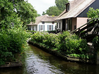 Can you imagine a village with no roads? There is such a place in the Netherlands called Giethoorn (pronounced 'geethorn'). There are no roads and cars have to remain outside the village. The only access to the stunningly lovely houses in Giethoorn is by water, or on foot over tiny individual wooden bridges.
