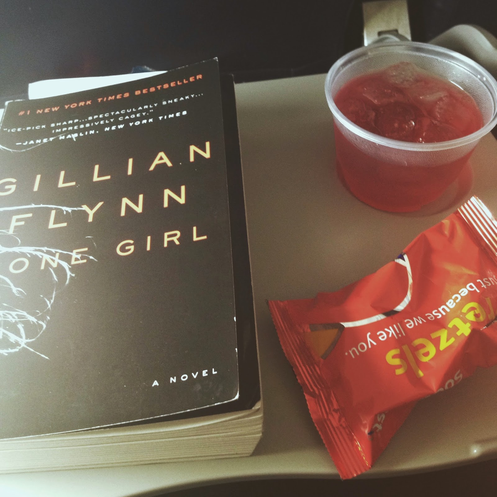 Airplane supplies, Gone Girl, pretzels and drink