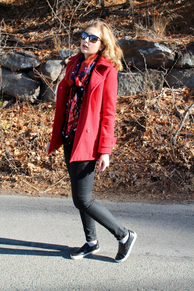 Red peacoat, red lipstick, black skinny jeans