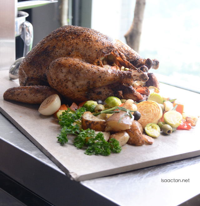At the carving station, a whole roasted turkey