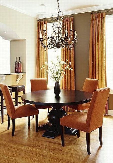 awesome traditional dining room with orange chairs and beautiful chandelier