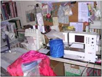 crowded sewing table with boxes underneath