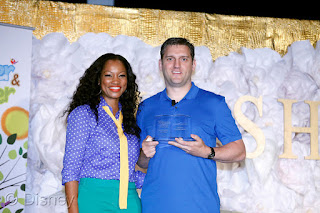 Garcelle Beauvais presents Steven Prusakowski from New Jersey with the Winnie the Pooh Storyteller of the Year Award.  Photo Credit: Raul Roa/Disney
