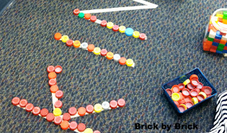 Building Letters with Tape and Lids (Brick by Brick)