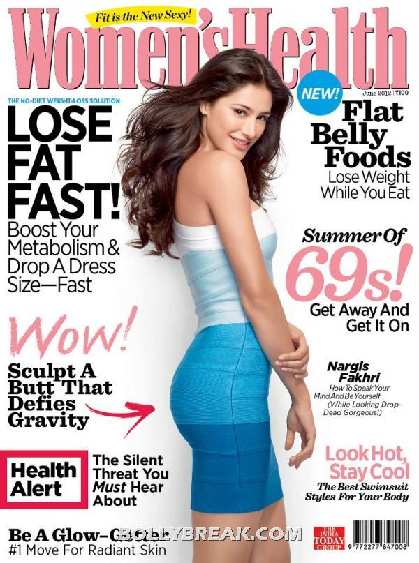 Nargis Fakhri in a multi toned blue tube dress on cover of. Womens Health -  Nargis Fakhri Women's Health Magazine June 2012
