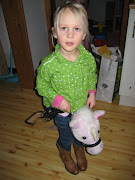 Cowgirl Saga in her new boots carrying her new cap pistol.