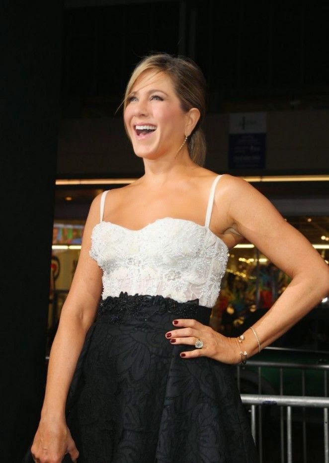 Jennifer Aniston beamed a big smile in a white top and dark skirt during another Horrible Bosses 2 agenda on Thursday night.
