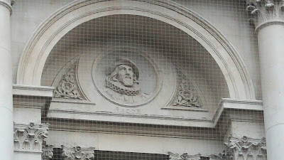 The face of Sir Francis Bacon, carved into (or out of) the side of a building.