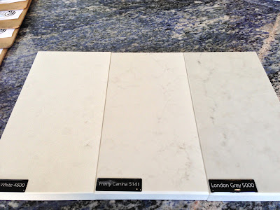 Caesarstone sample in Organic white, frosty carrina, london grey