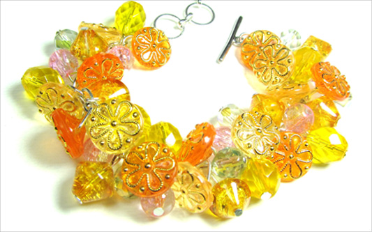 Dramatic bracelet has stunning yellow flower buttons and clusters of shiny Czech beads