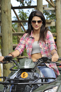 Shraddha Das on a Bikie spicy choli visible in movie Mogudu Must see