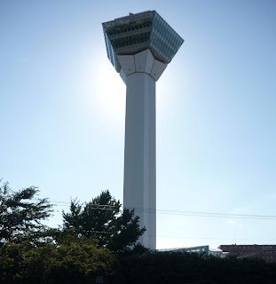 View of Goryokaku tower with sun behind it
