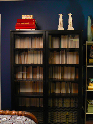 mylittlehousedesign.com blue walls and black bookcase with glass doors