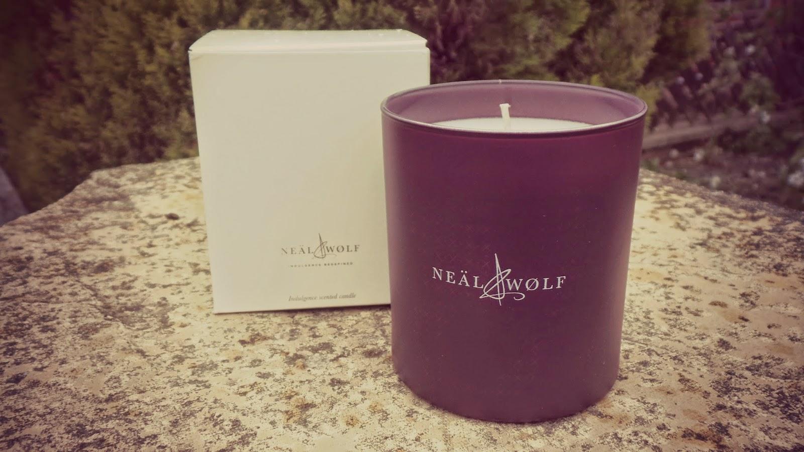 candle in purple glass jar