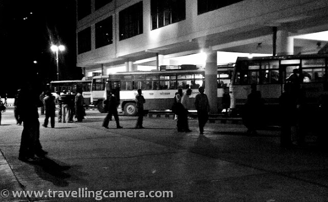 In October I was in Shimla and was coming back to Delhi in Night Bus. I reached new bus stand at 8:00 pm while bus had to start at 9:20 pm. New Bus Stand in Shimla is fabulous and I thought of doing some mobilegiri there... Above photograph was taken during day time while I was at Indian Institute of Advanced Studies, but shot is taken by HTC Desire Camera :) Before I start sharing photographs of Shimla Bus Stand, let me share something about HRTC services, which have improved a lot in my opinion. Now HRTC have Volvos, TATA-AC and Deluxe buses running between main stations in Himachal. Most of these buses are very comfortable. I don't think, I need to tell anything about Volvos, but at the same time TATA-AC are decent buses with confortable seating and AC. Main different is brand and the other can felt while in hills. So if you go to Shimla from Delhi, it would be hard to feel the difference between Volvo and Tata-AC, as road is wonderful. Deluxe buses have comfortable seating but no AC. Apart from that most of the TATA-AC and Volvos have got LCDs for running movies or other videos...Shimla Bus-stand has different parking areas located at different levels of this building. This particular area seems for Haryana buses and with time, all types of buses can be seen on a particular stand. So all of these buses would move to respective counter as they have to start for their next destinations.Here is the area with most of the hustle-bussle, as all passengers are looking for their buses and boarding accordingly.There is more than enough space inside the Bus-Stand to sit and wait. All the levels of this bus stand are clean as of now and well maintained. Hope Himachal Pradesh government and employees keep this going in same fashion.There are clean and appropriate options for eatable & drinks...All current and advanced booking counters are located on ground floor. Temporary counters are also available near the place where buses are parked to pick passengers.If someone is sitting inside the bus-stand and waiting for the bus, s/he need not to go outside to see if bus has come or not. Whole area is covered with transparent glass.Apart from that, LED displays are also installed at most of the places. These LED displays show the buses currently on counter with respective information like Departure time, Counter Number, Bus Number etc.Most of the levels are connected through stairs as well as lifts. I didn't come across any escalator, which was a bit surprising thing.Here is a photograph of frontal portion of new bus stand of Shimla, which is located near Tootikandi...This is a huge area and Shimla's new bus stand is considered as one of the best bus-stands in North India. In fact Delhi's Bus Stand is under renovation, so let's see how it turn out.From entry of this Bus stand, it looks like some shopping Mall or a very luxurious office space. It was hard to digest the fact that it's Bus Stand of Capital City of Himachal Pradesh :)Bokeh of colorful lights on surrounding hills...HRTC Buses can be booked online now at www.hrtc.gov.in/ . It's really very helpful for folks to see availability online and book their tickets without waiting in long queues.This was old Bus-stand of shimla, which has been converted into local bus-stand now. There are regular shuttles between local Bus Stand and ISBT Shimla.