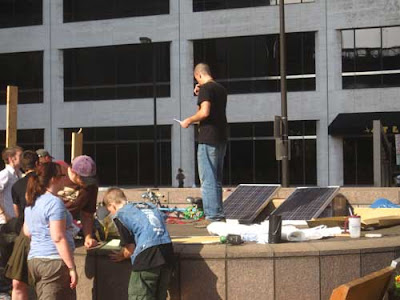 Man and two solar panels