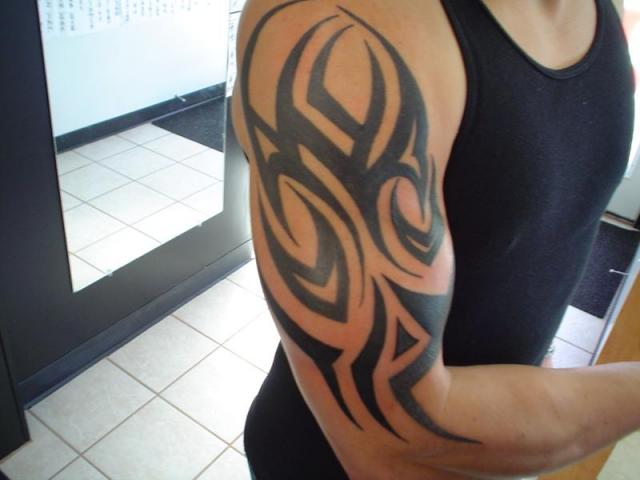tribal-half-sleeve-tattoo.jpg