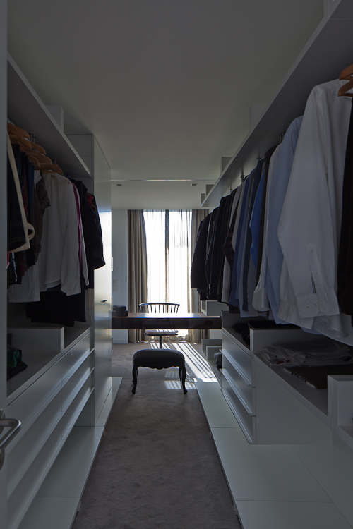 Walk in closet in Black Concrete House by Pitagoras Arquitectos