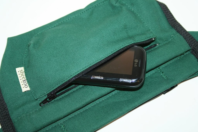 outside pocket with zipper holding a cell phone