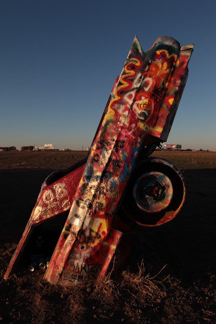 One of the Cadillacs buried nose first at Cadillac Ranch on Route 66 near Amarillo.
