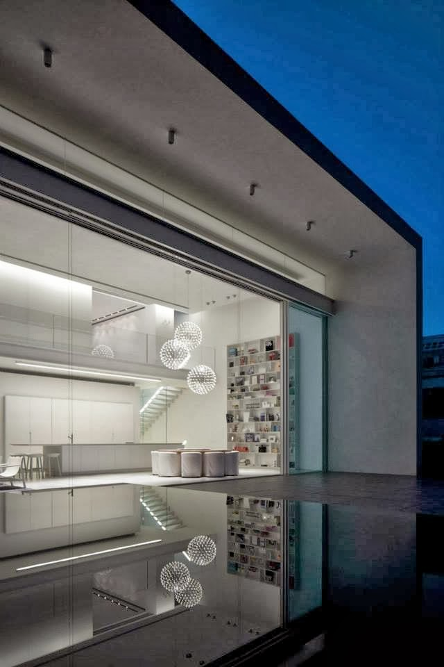 Facade of White Ramat Hasharon House by Pitsou Kedem Architects at night