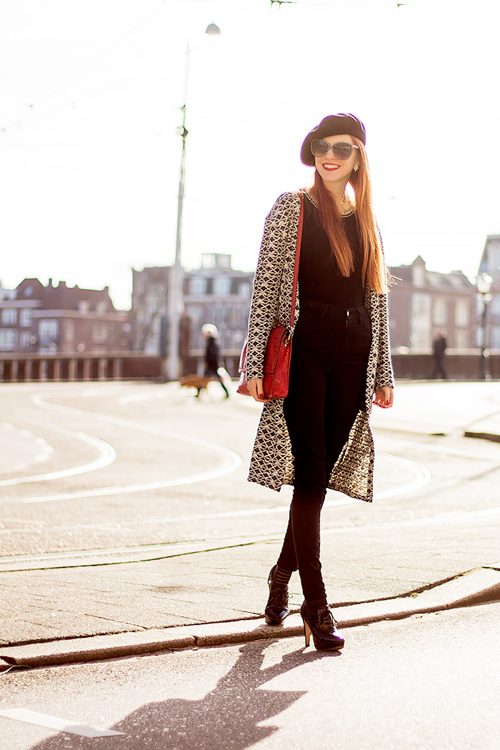 Retro fashion blogger outfit with a long aztec cardigan, beret, high waisted jeans and sheer striped socks