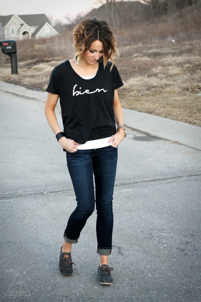Black graphic tee, dark denim, TOMs