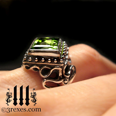 silver raven love gothic wedding ring with green peridot on model