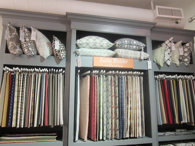 Nbaynadamas pillows in cubbies above designer Katie Ridder's textile collection