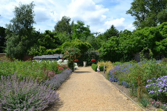 A footpath between flower beds in the walled garden